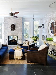 If you live in a more temperate climate, enjoy your porch throughout the year by adding screens and a fireplace. Here, light bricks on the fireplace surround echo the surfacing of the home. The hearth is surrounded by plenty of seating, ensuring a large group of guests can all enjoy the comforts of the fireplace.