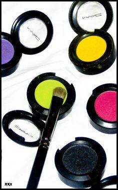 I love my M.A.C. eyeshadow. Also, such a pretty photograph!