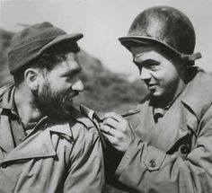 Bill Mauldin legendary cartoonist creator of the Willie and Joe characters beloved by the rank-and-file in World War II. This photo of Mauldin (right) and a soldier was taken in Anzio Italy ca. 1944.