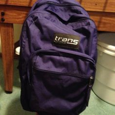 Purple Trans Bookbag Beautiful purple Bookbag. There's plenty of room for all your essential needs. Very sturdy and stylish. Trans Bags Backpacks