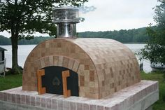 The ULTIMATE Father and Son DIY Project!  The Kenny Family in Maine built this beautiful Wood Fired Pizza Oven using the Cortile Barile foam pizza oven forms and supplies from Gagne & Son.  BrickWoodOvens.com