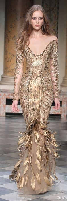 Zuhair Murad Spring/Summer 2011  The feathers floating in sheer skirt is fascinating. Gives rise to other applications of this idea.