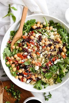 This healthy quinoa salad is one of the easiest you'll make thanks to staples like roasted red bell peppers, kalamata olives and feta from your fridge and pantry. | foodiecrush.com