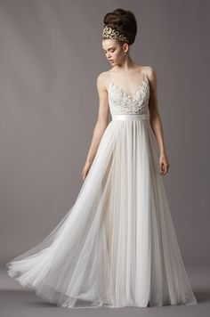 Watters, Fall 2013 ...lace and tulle wedding gown ... Ivory a line Wedding dress ...   I think this is something I would like to wear at the reception and call it my after ceremony dress. That I would change into do that I was more comfy and can enjoy the reception with over heating and feeling like a tent in my wedding dress also do I don't get spillage on the wedding dress!! :)