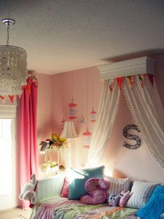 Create the look of a canopy bed while using the frame of a twin-sized, girls' daybed. The canopy bed dressed up a pine cornice with white paint, trim and moldings for a more custom-made and feminine look. White fabric to the back side of the box and attached it to the wall. The result is a crisp addition to the pink walls and a soft, dramatic touch.