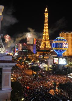 Fireworks burst over the Las Vegas Strip at midnight on New Year's 2014, as seen from the The Cosmopolitan of Las Vegas. Las Vegas officials expect to welcome approximately 335,000 visitors for the holiday. Wednesday, January 1, 2014. (Photo/Las Vegas News Bureau, Glenn Pinkerton