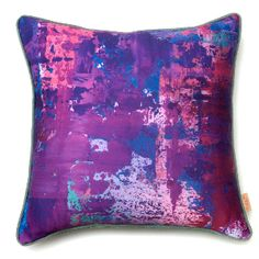"Susi Bellamy Strato Viola Cushion: Based on her original and unique abstract artwork, this vibrant cushion by UK artist Susi Bellamy is perfect for injecting some bold colour into a room, or what Bellamy terms ""art for the sofa."" Inspired by a great love of colour, her background as a fashion editor and time working and living in Florence, Bellamy's use of rich, exuberant tones and the layering and marbling of paint echo the rough texture of ancient Palazzo walls. Available in a range of…"