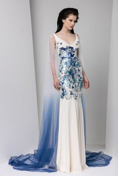 V-neckline Moroccan crepe dress, hand painted in shades of silver and blue, and an ombré tulle cape.