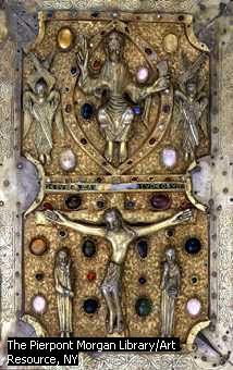 This jeweled book binding represents Christ at the Crucifiction;  made of ivory and gold plate inlaid with precious stones with silver corners.  c. 1000.