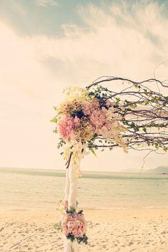 Floral arch on the beach. #wedding
