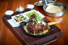 Lamb Shank Barbacoa: modelo braised, slow roasted, salsa borracha, roasted vegetables, black bean stew