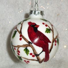Cardinal on a Holly branch Glass Christmas Ornament Hand Painted