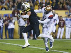Nov. 30 - Arizona safety Carter Hehr (37) can't stop ASU running back D.J. Foster (8) score in the fourth quarter of the 87th annual Territo...