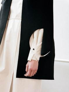 Cape Jacket with geometric cutouts; contemporary fashion details // Nadine Goepfert