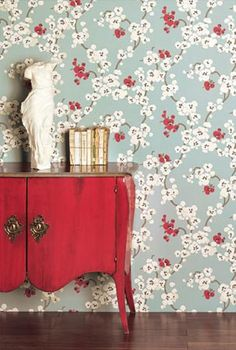 The red sideboard against that wallpaper....rocks!