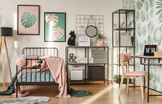 Create a beautiful botanical bedroom with printed walls and stylish open storage. Treat your teenager to these dusky pink tones and fun forest green accessories. Click for more top teen bedroom inspiration.