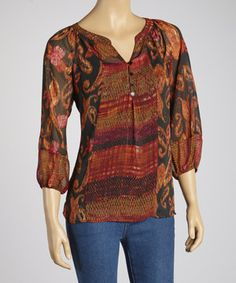 Posh prints combine with a button-up silhouette, while tapered sleeves and a troop of buttons make it one trendy top.