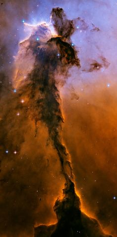 Appearing like a winged fairy-tale creature poised on a pedestal, this object is actually a billowing tower of cold gas and dust rising from a stellar nursery called the Eagle Nebula. The soaring tower is 9.5 light-years or about 90 trillion kilometres high, about twice the distance from our Sun to the next nearest star. Stars in the Eagle Nebula are born in clouds of cold hydrogen gas that reside in chaotic neighbourhoods,