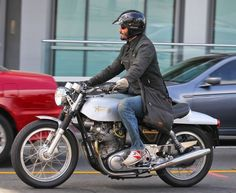 Actor Keanu Reeves riding his motorcycle around Los Angeles, California on April 6, 2013.