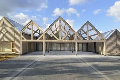 A long run of gabled volumes clad in honey-coloured timber has been designed by Tracks Architectes for a kindergarten called La Ruche, or The Beehive. Gable Window, Bay Window, Architecture Design, School Architecture, Timber Planks, Wooden Cladding, Water Collection, Kindergarten Lesson Plans, The Gables