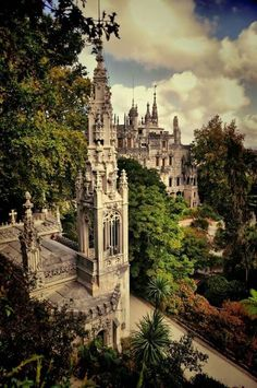 "The dreamy Quinta da Regaleira in Sintra, Portugal. lso known as ""Palace of Monteiro the Millionaire"", this romantic escapade of Quinta da Regaleira near the city center of Sintra, Portugal is listed as a World Heritage Site by UNESCO. Places Around The World, Oh The Places You'll Go, Places To Travel, Places To Visit, Around The Worlds, Spain And Portugal, Portugal Travel, Portugal Trip, Beautiful Buildings"