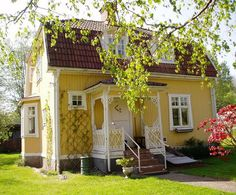 Just adorable! precious yellow cottage - like a play house for grown ups