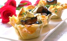 Looking for an impressive dinner party starter?  These Brie and Mushroom Phyllo Cups will knock the socks off your guests!