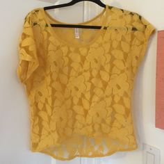 Yellow lace crop top, cut like a high-low. I am wearing an awkward shaped tank top underneath. It is a great tip for layering or wearing with rompers. Xhilaration Tops Crop Tops