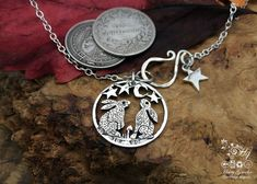 handmade and recycled silver shilling coin moon gazing hare necklace - this guy's work is magical.