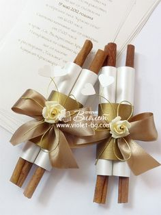 scroll wedding #invitations from www.violet-weddinginvitations.com I love that they used cinnamon sticks (looks like). Makes me wonder what else you could use that smells and looks great.