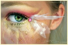 Eye make-up inspired by Disney's Tinkerbell complete with fairy dust, a pink crystal and a bow.
