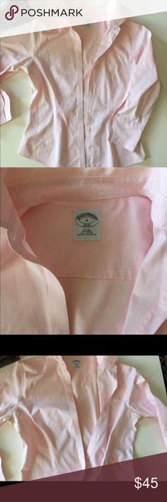 Brooks Brothers no-iron pink button down shirt Gorgeous brooks brothers shirt. This is the popular no-iron non- wrinkle material that is super crisp. This is a three quarter length sleeve. Very gently worn with slight discoloration along the back of the neck but barely noticeable! Size 4. Brooks Brothers Tops Button Down Shirts