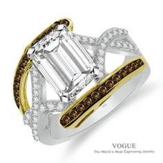 Celebrate Your Love with this Emerald Cut Center Diamond set in 14k White and Yellow Gold with Coco Diamond Accents.