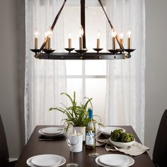 Rustic meets contemporary in this beautiful Cavalier chandelier. The frame showcases a large black metal ring suspended from leather straps and supporting nine 60-watt lights, this chandelier offers an elegant aesthetic for the modern home.