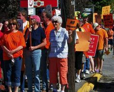 Demonstrators march down Main Street in Colebrook to protest the Northern Pass project at a rally that drew more than 200 protesters from across the North Country.