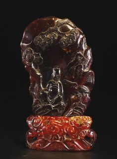 n amber carving and a stand; Stand, Qing dynasty, 18th century; Carving, Qing dynasty, 19th century