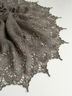 This crescent shaped, beaded, lace shawl is pretty, sophisticated and yet quite easy to knit and has an ethereal quality harking back to an era of timeless elegance.