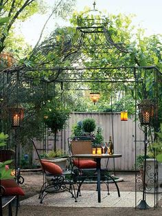 "Build a Backyard Retreat: Airy Gazebo Create an instant ""room"" with a garden structure. This filigreed wrought-iron gazebo defines the dining space without blocking the sunset, the stars, or the breeze. Outdoor Rooms, Outdoor Dining, Outdoor Gardens, Dining Area, Small Dining, Dining Table, Gazebo Pergola, Pergola Kits, Pergola Ideas"