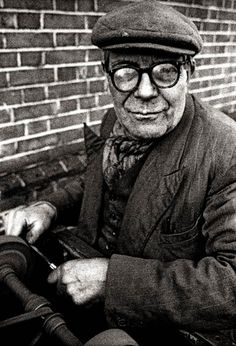 """John Claridge, Knife Grinder, E13 (1966) - """"Every few weeks he would appear at the end of the street. Quite a cross-section of people had their knives sharpened!"""""""