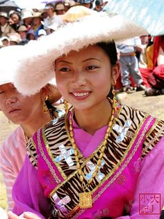 Litang Horse Festival, 2008 or earlier | Tibetan woman in traditional clothes. This is the same woman as dressed in ceremonial costume in these photos:  http://pinterest.com/pin/268456827758084237/  http://pinterest.com/pin/268456827758084235/  The clothes she wears here are traditional tibetan clothes for frequent wear. The ceremonial costumes are extremely heavy, so worn only a few days a year