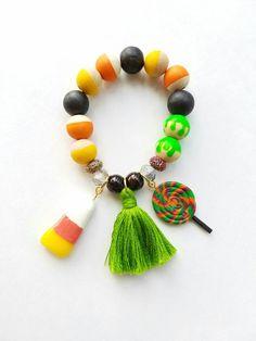 Halloween candy charms beaded tassel bracelet. Halloween Bracelet, Candy Corn Charm, Candy Charms, Hand Painted Bracelet by TheRockinBead on Etsy