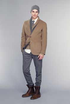 Shop this look on Lookastic:  https://lookastic.com/men/looks/blazer-cardigan-dress-shirt-dress-pants-brogue-boots-beanie-tie/12970  — Charcoal Beanie  — White Dress Shirt  — Charcoal Wool Tie  — Brown Wool Blazer  — Brown Cardigan  — Charcoal Dress Pants  — Dark Brown Leather Brogue Boots