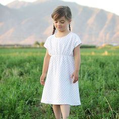 Free sewing pattern and tutorial for an easy to sew girls' play dress in multiple sizes. How to sew a dress using knit fabric.