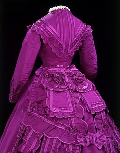 A silk dress from the 1860s. The vivid colour of this dress was achieved through the use of synthetic dyes first discovered by the British chemist William Perkins in the 1850s. These dyes, which were extracted from coal tar and were known as aniline dyes, became extremely fashionable and produced intense colours which could not be made using traditional natural dyes.