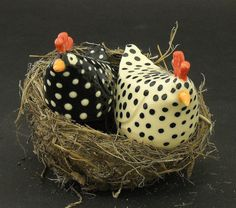 leesfamous.com     http://www.etsy.com/listing/113374530/salt-and-pepper-black-and-white-ceramic