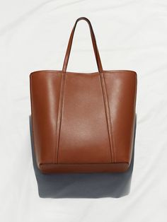 260005-560 - Department 2 Women Type 60 Bags Product 260005 Material 560 Leather - Portrait tote, made in Italy from chrome-free tanned leather with a secchiello ('bucket') construction. Height 39cm, width 32cm, depth 13cm, handle drop 22cm. Leather lining and inside leather pocket. Top-stitched side panels and painted edges. #ARKET