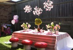 Table at a fairy party (love the mushroom stools!) #fairyparty #tabledecor
