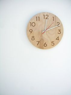 Modern Numbers Clock in Natural Birch.  A modern classic that works well in kitchens, nurseries, offices, and bathrooms.
