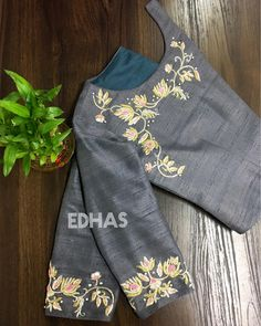 EDHAS- every dress has a story! Designer boutique in MVP colony Contact us - 08912786788 . Grey over coat embellished with crystals,… Simple Blouse Designs, Stylish Blouse Design, Saree Blouse Neck Designs, Bridal Blouse Designs, Kurta Designs, Designer Blouse Patterns, Embroidery Blouses, Simple Embroidery, Embroidery Designs
