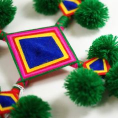 These lovely handmade Ojos de Dios were made by the Huichol Indians of Mexico. Do you remember making these in when you were little? Mine were not this well made, I assure you. The Huichol are a group